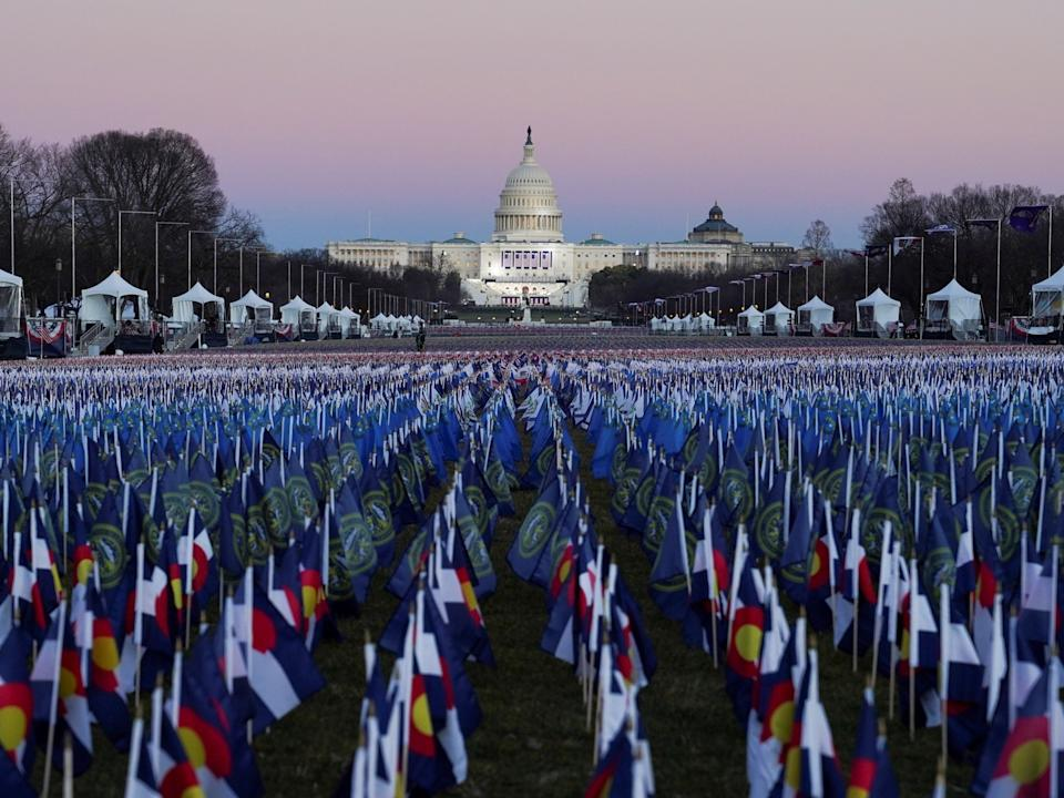 The 'Field of Flags' on the National Mall is seen in front of the Capitol building, representing those not able to attend the celebrations due to the Covid-19 pandemicREUTERS