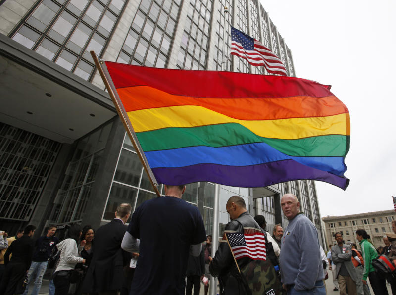 FILE - In this Aug. 4, 2010 file photo, same-sex marriage supporters gather outside a federal building and wait for a judge's decision overturning California's same-sex marriage ban in San Francisco. On Tuesday, the US Supreme Court will begin hearing two days of cases involving gay marriage. (AP Photo/Eric Risberg)
