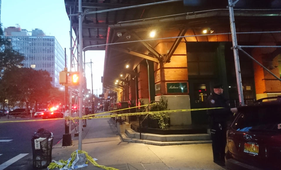 <em>A police officer blocks off an area responding to reports of a suspicious package in the Tribeca neighbourhood (AP)</em>