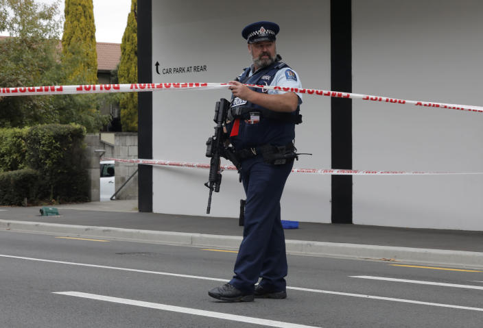 A police officer stands guard near the Masjid Al Noor mosque in Christchurch, New Zealand, Saturday, March 16, 2019, where one of the two mass shootings occurred. A white supremacist suspected in shootings at two mosques that killed 49 people during midday Friday prayers posted an anti-immigrant manifesto online and apparently used a helmet-mounted camera to broadcast live video of the slaughter on Facebook. (AP Photo/Vincent Yu)