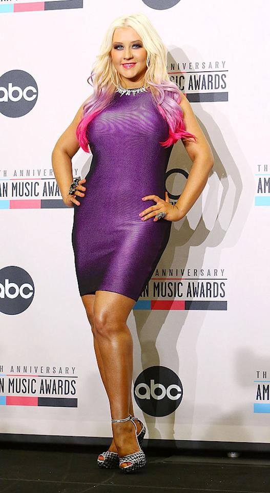 "<p class=""MsoNormal"">Christina Aguilera poured herself into an extremely form-fitting purple frock, which perfectly matched her pink-and-purple hair tips, to announce the American Music Award nominees. While we love a girl with curves, we can't help but think ""The Voice"" judge probably could have used a little more breathing room. Even her ankle-strap shoes look too tight! (10/9/2012)</p>"