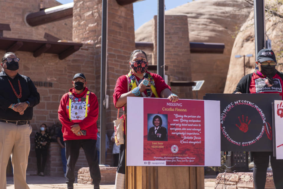 In this image provided by the Navajo Nation Office of the Speaker, Navajo Nation Council Delegate Amber Kanazbah Crotty, center, addresses a crowd gathered, Wednesday, May 5, 2021, in Window Rock, Ariz., during an event to commemorate a day of awareness for the crisis of violence against Indigenous women and children. (Byron C. Shorty, Navajo Nation Office of the Speaker via AP)