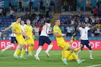 Harry Maguire (C) runs off in celebration after scoring England's second goal at the Stadio Olimpico