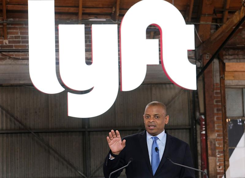 "Anthony Foxx, chief policy officer of Lyft Inc., speak during a ceremonial opening bell in Los Angeles, Friday, March 29, 2019. On Friday the San Francisco company's stock will begin trading on the Nasdaq exchange under the ticker symbol ""LYFT."" (AP Photo/Ringo H.W. Chiu)"