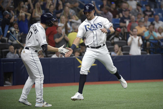 Tampa Bay Rays' Nate Lowe, right, is congratulated by Austin Meadows (17) after scoring on a wild pitch by Boston Red Sox relief pitcher Josh Taylor during the seventh inning of a baseball game Friday, Sept. 20, 2019, in St. Petersburg, Fla. (AP Photo/Phelan M. Ebenhack)