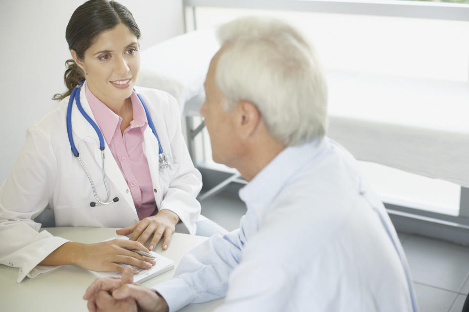 Doctor talking to a patient sitting at a table