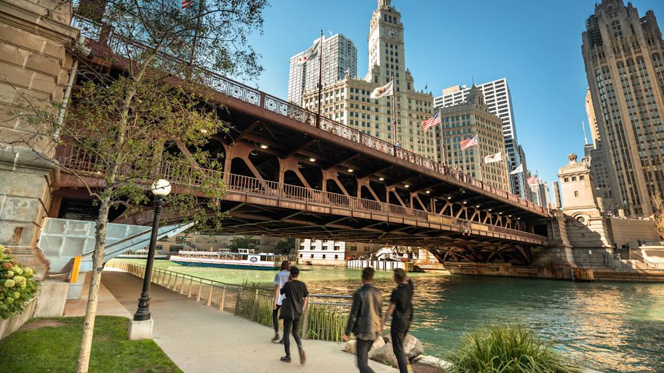 Chicago, Illinois, USA - September 22, 2018:  People walk under the DuSable Bridge over the Chicago River in downtown Chicago Illinois USA during a summer day.