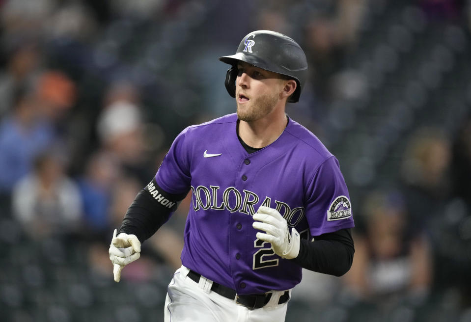 Colorado Rockies' Ryan McMahon gestures toward the dugout as he heads up the first-base line after hitting a solo home run off Arizona Diamondbacks relief pitcher Riley Smith in the fifth inning of a baseball game Friday, May 21, 2021, in Denver. (AP Photo/David Zalubowski)