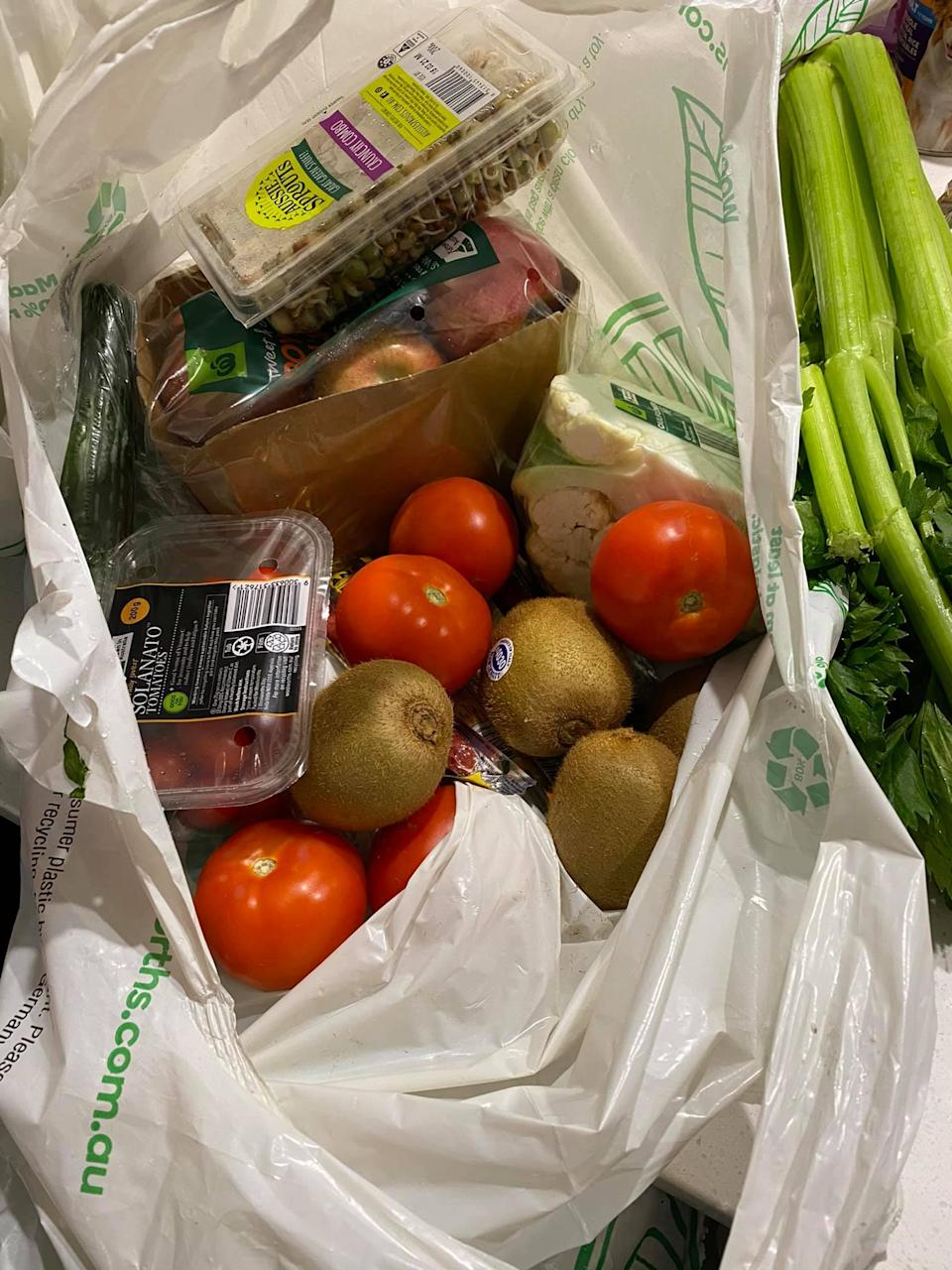Becky Kissin's Woolworths order, showing fruit and vegetables piled into a single bag.