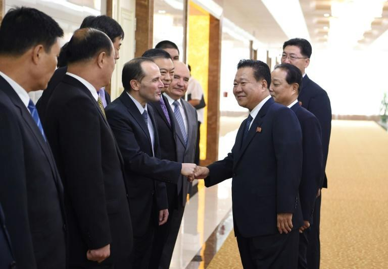 The sanctioned officials include Choe Ryong Hae (C), who has been considered a right-hand man to Kim