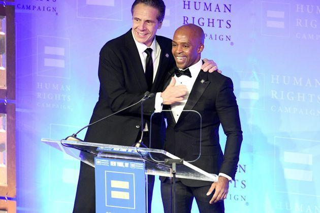 New York Gov. Andrew Cuomo is welcomed to the stage by Human Rights Campaign President Alphonso David during a gala for the organization in February 2020. (Photo: Gary Gershoff via Getty Images)