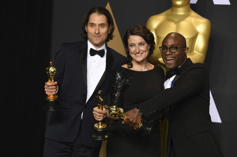 """Jeremy Kleiner, from left, Adele Romanski and Barry Jenkins, winners of the award for best picture for """"Moonlight"""", pose in the press room at the Oscars on Sunday, Feb. 26, 2017, at the Dolby Theatre in Los Angeles. (Photo by Jordan Strauss/Invision/AP)"""