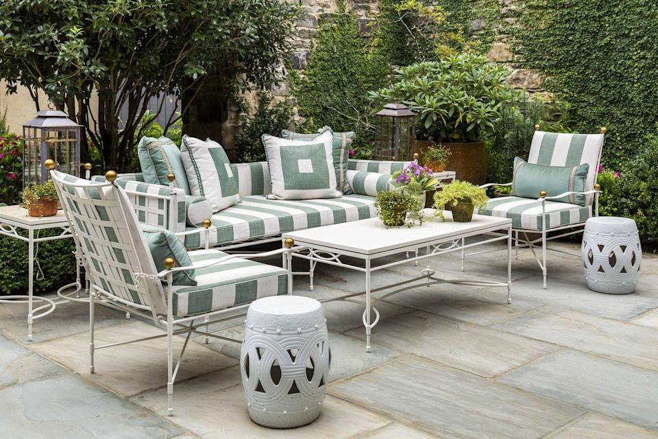 """<p>On the patio, we took one pattern (a striped performance textile from <a href=""""https://www.perennialsfabrics.com/"""" rel=""""nofollow noopener"""" target=""""_blank"""" data-ylk=""""slk:Perennials"""" class=""""link rapid-noclick-resp"""">Perennials</a>) and cut it into concentric squares for some of the toss cushions. The juxtaposition against the striped cushions creates an energetic vibe that's not overwhelming. The furniture (from <a href=""""https://www.janusetcie.com/"""" rel=""""nofollow noopener"""" target=""""_blank"""" data-ylk=""""slk:Janus et Cie"""" class=""""link rapid-noclick-resp"""">Janus et Cie</a>) is all cast in the same finish, allowing the patterned cushions to truly stand out.</p><p><em>Landscape Design: <a href=""""http://www.richardandersonla.com/"""" rel=""""nofollow noopener"""" target=""""_blank"""" data-ylk=""""slk:Rick Anderson"""" class=""""link rapid-noclick-resp"""">Rick Anderson</a>. </em></p>"""