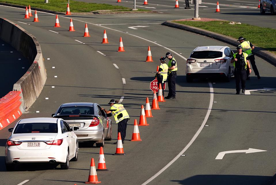 Motorists are questioned by Queensland police at the Queensland / New South Wales border checkpoint in Coolangatta, on the Gold Coast, Tuesday, December 22, 2020.