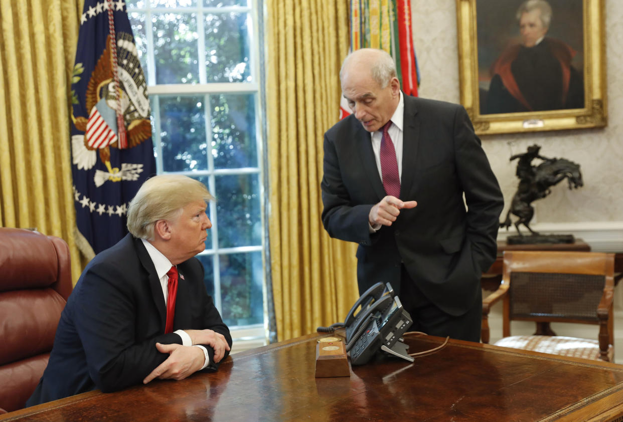 Kelly speaks with President Trump after a meeting to discuss potential damage from Hurricane Michael, in the Oval Office on Oct. 10, 2018. (Photo: Pablo Martinez Monsivais/AP)