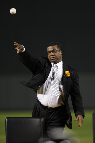 FILE - In this Aug. 11, 2012 file photo, former Baltimore Oriole Eddie Murray throws out the ceremonial first pitch before a baseball game between the Orioles and the Kansas City Royals in Baltimore. The Securities and Exchange Commission announced that Murray has agreed to settle federal civil charges of profiting in stock trades by using confidential information passed to him by a former teammate. (AP Photo/Nick Wass, File)