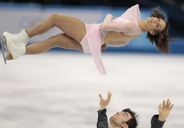 Meagan Duhamel and Eric Radford of Canada compete in the pairs short program figure skating competition at the Iceberg Skating Palace during the 2014 Winter Olympics, Tuesday, Feb. 11, 2014, in Sochi, Russia. (AP Photo/Ivan Sekretarev)