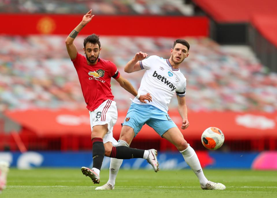 Manchester United's Bruno Fernandes (left) in action with West Ham United's Declan Rice.