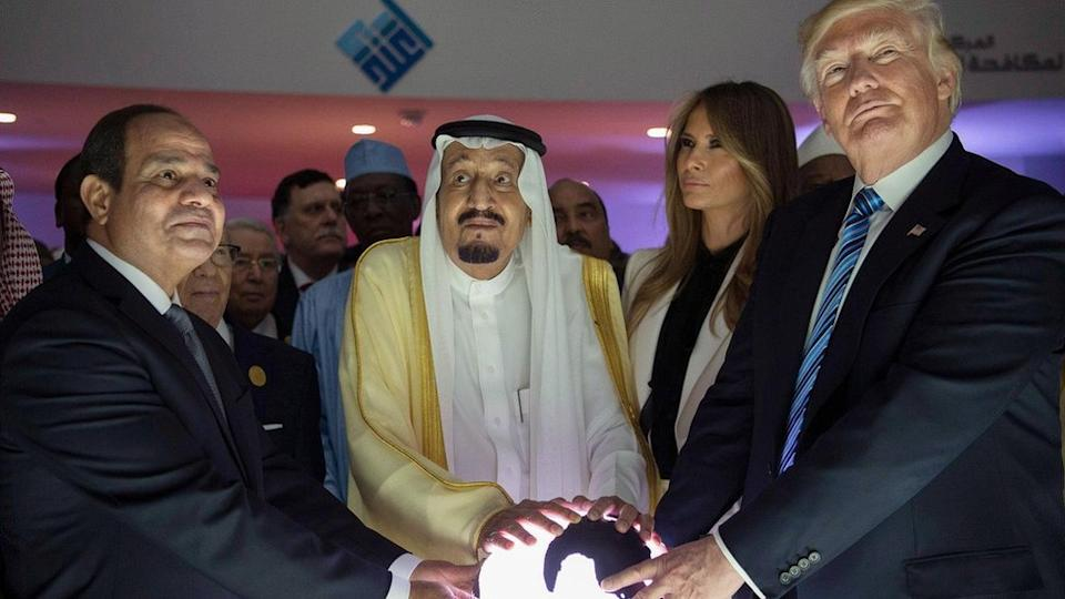 Egyptian President Abdul Fattah al-Sisi, Saudi King Salman and US President Donald Trump place their hands on a glowing globe at the opening the World Centre for Countering Extremist Thought in Riyadh, Saudi Arabia (21 May 2017)