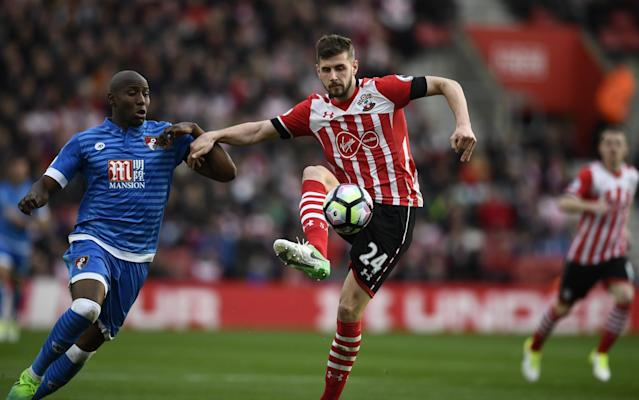 <p>Bournemouth's Benik Afobe in action with Southampton's Jack Stephens </p>
