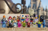 Minifigs on display in front of Sleeping Beauty's castle.