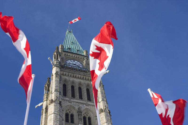 Parliament of Canada, Peace Tower, Canadian Flags, Ottawa. Getty Images