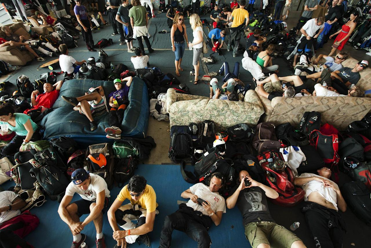 Skydivers rest in a hangar, Thursday, Aug. 2, 2012, in Ottawa, Ill. More than 140 skydivers reaching speeds in excess of 180 mph gathered in the skies over central Illinois to set a new world record in vertical flying. (AP Photo/Sitthixay Ditthavong)
