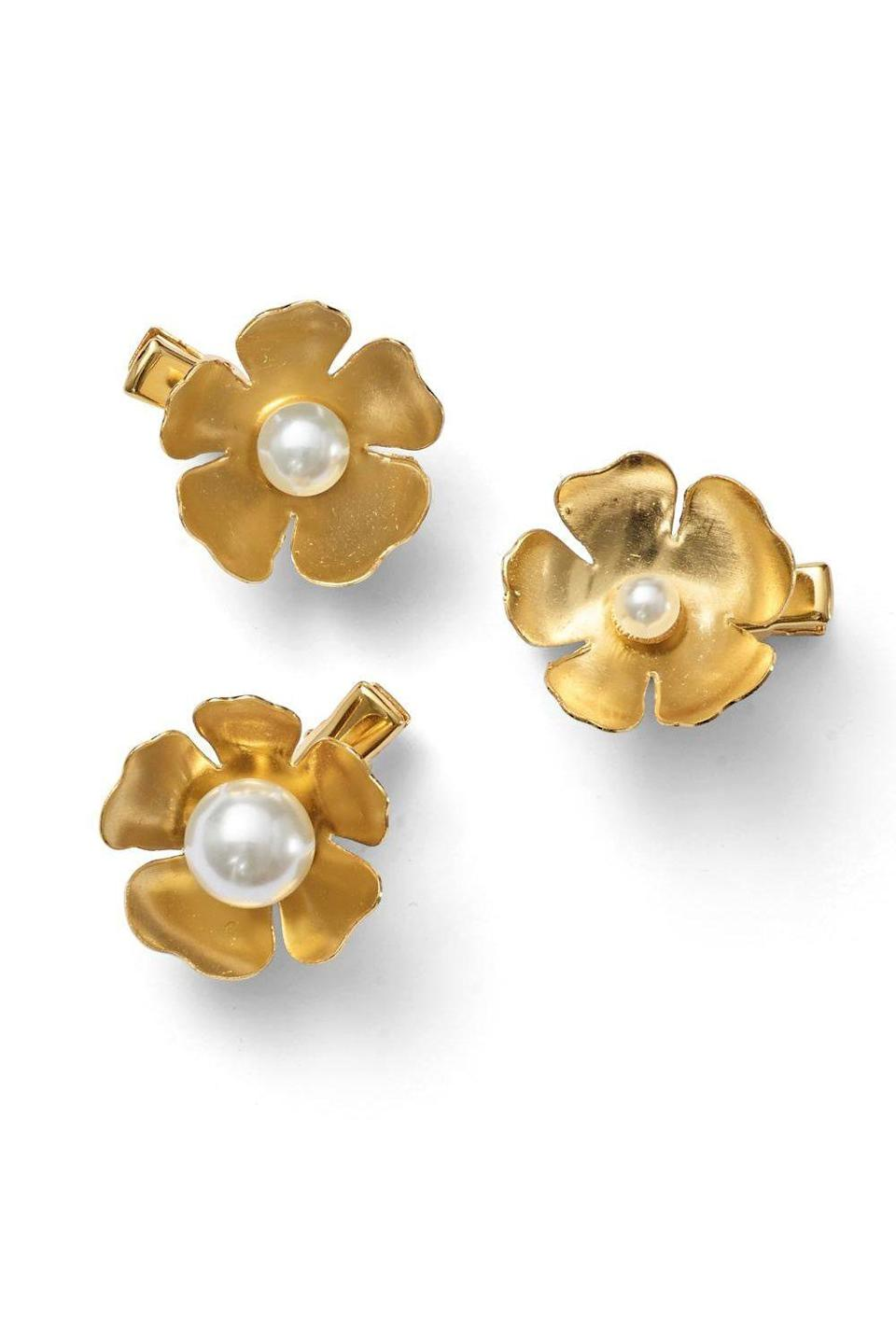 """<p><strong>$168.00</strong></p><p><a href=""""https://leletny.com/collections/clips/products/philippa-pearl-flower-clip-set-of-3"""" rel=""""nofollow noopener"""" target=""""_blank"""" data-ylk=""""slk:Shop Now"""" class=""""link rapid-noclick-resp"""">Shop Now</a></p><p>With this <strong>set of 14k gold clips</strong>, you truly don't need jewelry to wear with it. And thanks to their flower shape, they're also perfect for spring.</p>"""