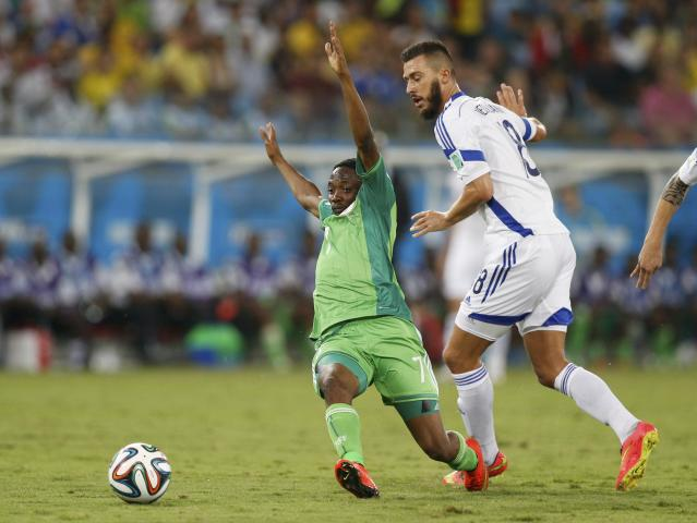 Nigeria's Ahmed Musa is fouled by Bosnia's Haris Medunjanin, which led to a yellow card, during their 2014 World Cup Group F soccer match at the Pantanal arena in Cuiaba June 21, 2014. REUTERS/Ueslei Marcelino (BRAZIL - Tags: SOCCER SPORT WORLD CUP TPX IMAGES OF THE DAY)
