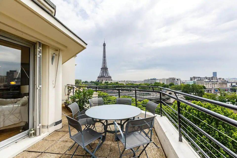 """<p>With two floors and 120 square metres of space, this Airbnb in Paris with incredible views from the terraces is magnifique. It overlooks the River Seine and past guests say you can """"almost touch the Eiffel Tower"""". When you're not dining alfresco on the terrace or relaxing with a book on the sun lounger, there are spaces to unwind inside, with a mixture of art deco style and modern furniture throughout.</p><p><strong>Sleeps:</strong> 4</p><p><strong>Price per night: </strong>£366</p><p><a class=""""link rapid-noclick-resp"""" href=""""https://airbnb.pvxt.net/qnEbdy"""" rel=""""nofollow noopener"""" target=""""_blank"""" data-ylk=""""slk:SEE INSIDE"""">SEE INSIDE</a><br></p>"""