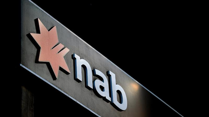 NAB has slashed its payout again as the bank's full-year profit dropped 10.6 per cent to $5.1bn