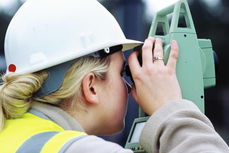 Woman engineer surveying, Angelsey waste water treatment upgrading works, Wales, UK. (Photo by Adrian Greeman/Construction Photography/Avalon/Getty Images)