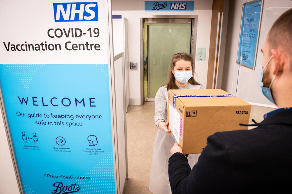 <p>A NHS Covid-19 vaccination centre at Boots, Halifax prepares to take patients</p> (PA)