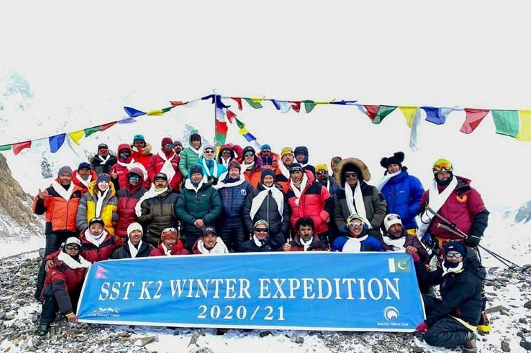 This handout photo taken on January 16, 2021 by Seven Summit Treks shows the historic team of 10 Nepali mountaineers and Sherpas after reaching the summit of K2, the second-highest mountain in the world, in the Gilgit-Baltistan region of Pakistan