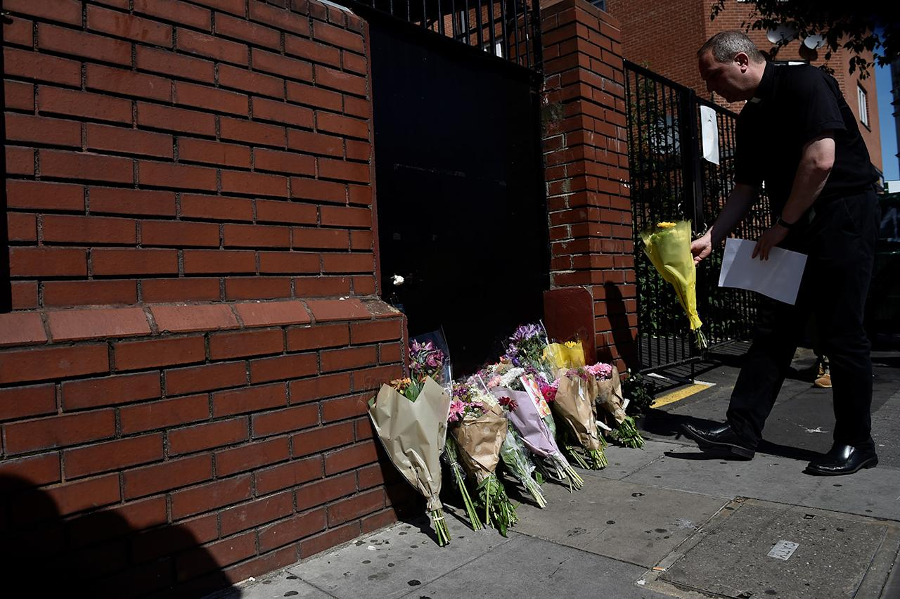 <p>A priest leaves flowers near the scene of an attack where a van was driven at Muslims outside a mosque in Finsbury Park in North London, Britain, June 19, 2017. (Photo: Hannah McKay/Reuters) </p>