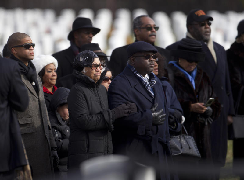 Jacqueline Weathers, widow of former Tuskegee airman retired Lt. Col. Luke Weathers, and others, watches her husband's casket arrive during burial services at Arlington National Cemetery in Arlington, Va., Friday, Jan. 20, 2012.  (AP Photo/Evan Vucci)