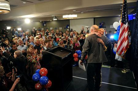 Representative elect Greg Gianforte hugs his wife, Susan, after delivering his victory speech during a special congressional election called after former Rep. Ryan Zinke was appointed to lead the Interior Department, in Bozeman, Montana, U.S., May 25, 2017. REUTERS/Colter Peterson
