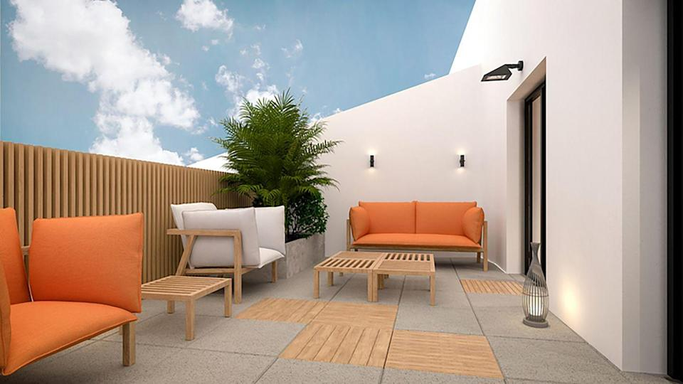 <p>It's okay to practice a bit of restraint when it comes to outdoor furniture. But to prevent a minimalist look from feeling too stark, pepper in colorful seating (you can't go wrong with orange). </p>