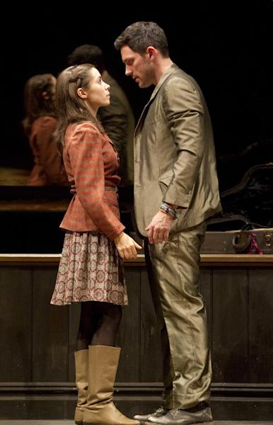 """In this theater image released by Boneau/Bryan-Brown, Steve Kazee, right, and Cristin Milioti are shown in a scene from """"Once,"""" in New York. (AP Photo/Boneau/Bryan-Brown, Joan Marcus)"""