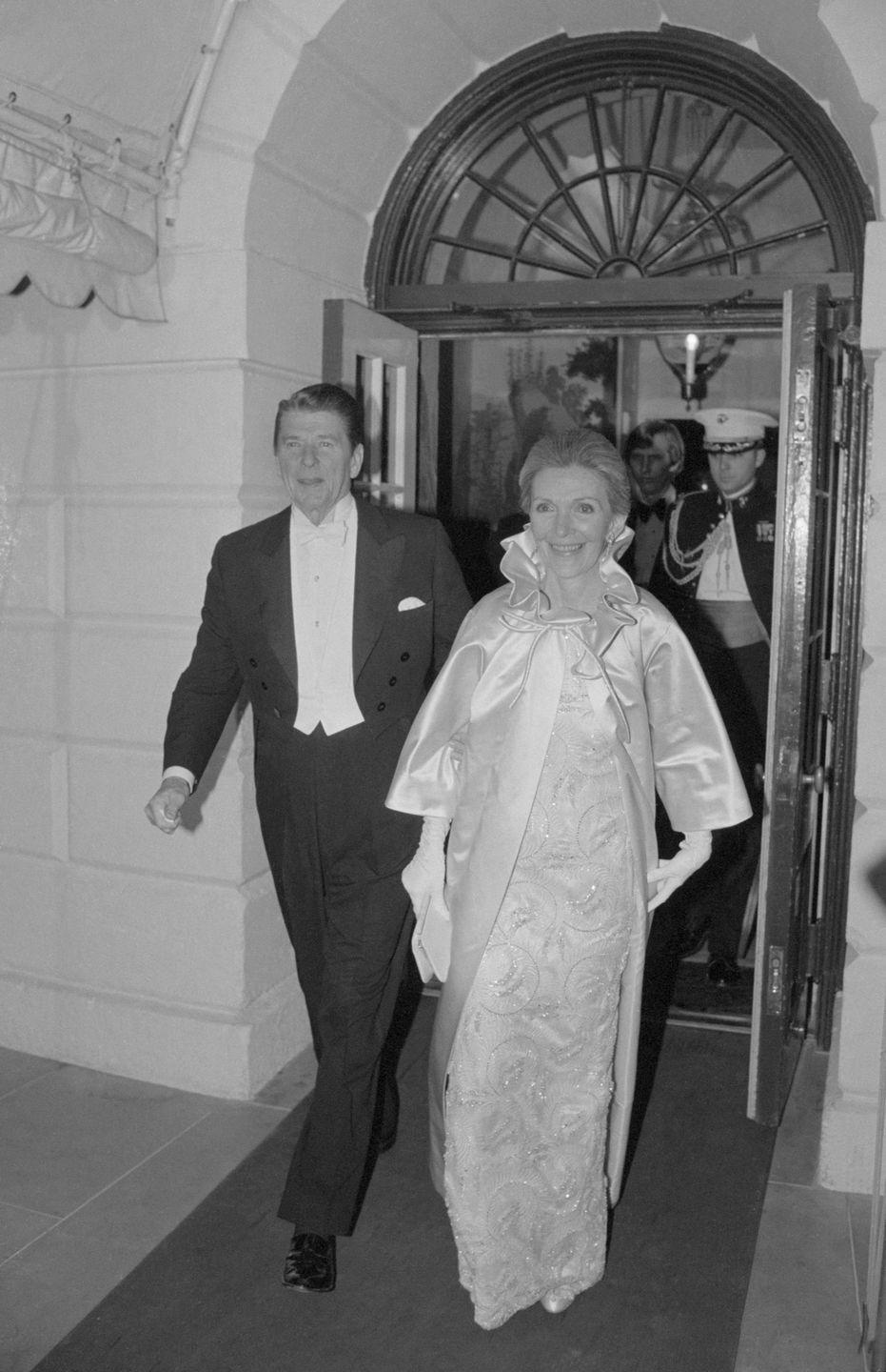 """<p>The Reagans depart from the White House in 1981 en route to the inaugural balls—yes, plural. The couple came under fire for the expense of their inaugural festivities, which included <a href=""""https://www.washingtonpost.com/archive/local/1980/12/10/eight-invitation-only-inaugural-balls-on-reagans-list-but-not-disco-party/34eb2c25-947c-4678-aa6a-a5b2953f07eb/"""" rel=""""nofollow noopener"""" target=""""_blank"""" data-ylk=""""slk:eight balls"""" class=""""link rapid-noclick-resp"""">eight balls</a> held at expensive venues, like The Kennedy Center and the Pension Building. </p>"""
