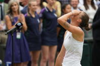 Czech Republic's Karolina Pliskova reacts after winning runners up during the presentation ceremony after her defeat bye Australia's Ashleigh Barty in the women's singles final on day twelve of the Wimbledon Tennis Championships in London, Saturday, July 10, 2021. (AP Photo/Alberto Pezzali)