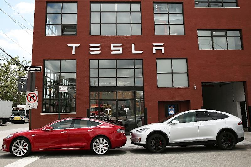 Tesla, which has seen strong demand for its electric cars, is ramping up efforts to become a mainstream producer (AFP Photo/SPENCER PLATT)