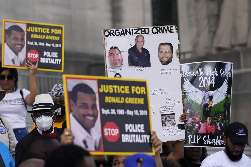 People hod signs during a rally outside the state capitol before a planned march to the Governor's mansion, protesting the death of Ronald Greene, who died in the custody of Louisiana State Police in 2019, in Baton Rouge, La., Thursday, May 27, 2021. (AP Photo/Gerald Herbert)