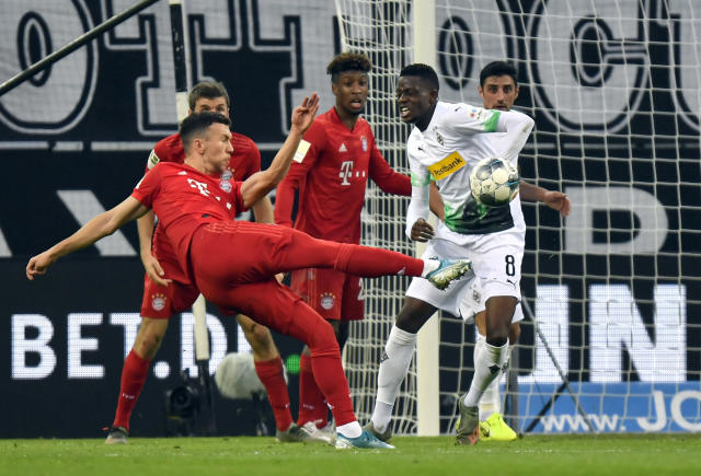 Bayern's Ivan Perisic takesa a shot at goal during the German Bundesliga soccer match between Borussia Moenchengladbach and Bayern Munich at the Borussia Park in Moenchengladbach, Germany, Saturday, Dec. 7, 2019. (AP Photo/Martin Meissner)
