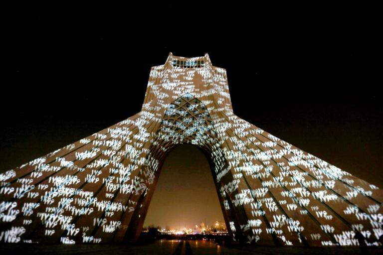 Iran's Azadi (Freedom) Tower is illuminated in honour of the victims of Ukraine International Airlines Flight 752, in Tehran
