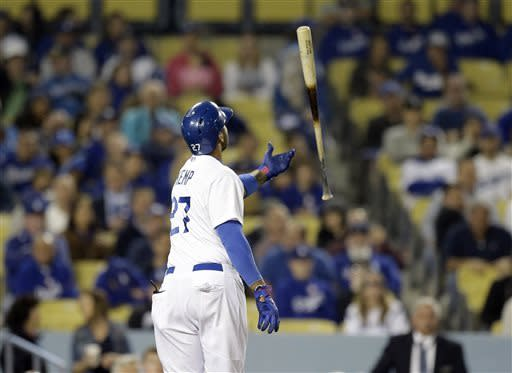 Los Angeles Dodgers' Matt Kemp tosses his bat after striking out to retire the side against the San Francisco Giants in the eighth inning of a baseball game in Los Angeles Wednesday, April 3, 2013. (AP Photo/Reed Saxon)