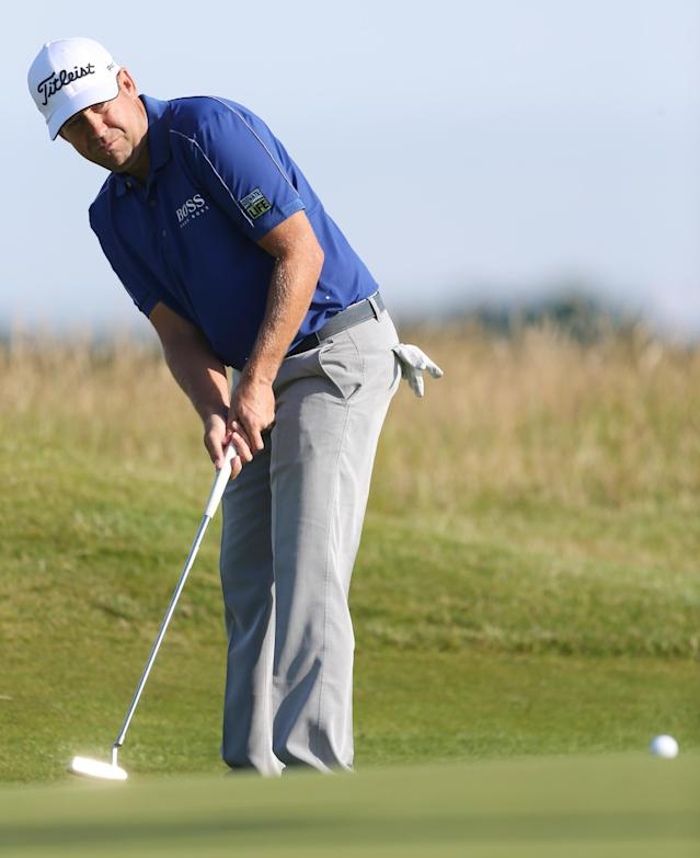 Erik Compton of the US putt on the 6th green during the first day of the British Open Golf championship at the Royal Liverpool golf club, Hoylake, England, Thursday July 17, 2014. (AP Photo/Peter Morrison)