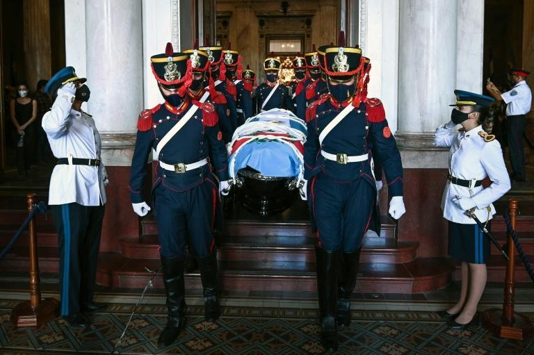 A handout picture released by the Argentine Senate shows the honour guards carrying the coffin of late former Argentine president (1989-1999) Carlos Menem during the funeral cortege at the Congress in Buenos Aires