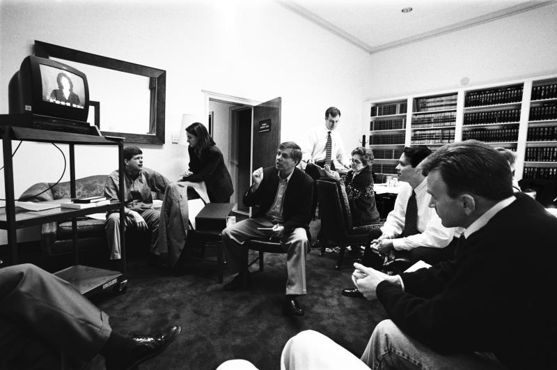 House Managers James Rogan and Lindsey Graham watch Monica Lewinsky on TV with Paul McNulty, Director of Legislative Operations for the House Majority Leader, and other staff in the Judiciary Committee Conference Room during the Senate Impeachment Trial of President Bill Clinton on Feb. 5, 1999 in Washington, DC. (Photo: David Hume Kennerly)/Getty Images)