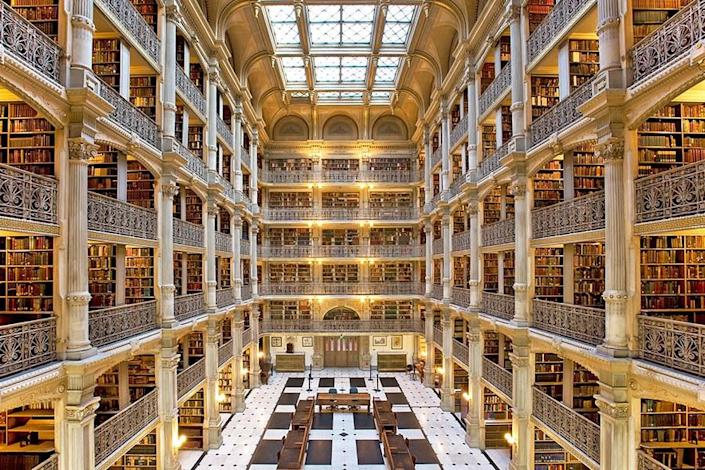 The Peabody Library, which opened in 1878, was designed by Baltimore architect Edmund G. Lind, in collaboration with Johns Hopkins University's first provost, Nathaniel H. Morison. Rising 61 feet, the central atrium features five tiers of cast-iron balconies, creating a dramatic effect.